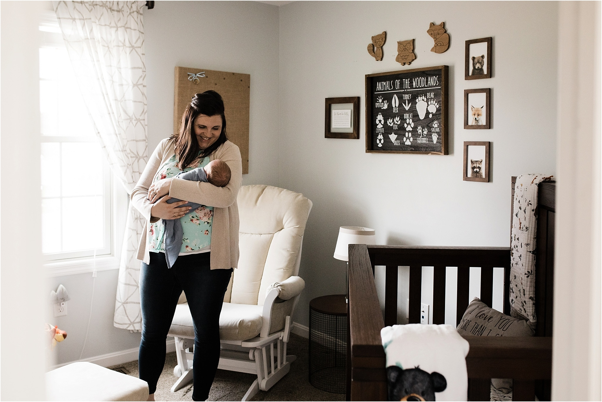mother and newborn boy in rustic outdoor themed nursery