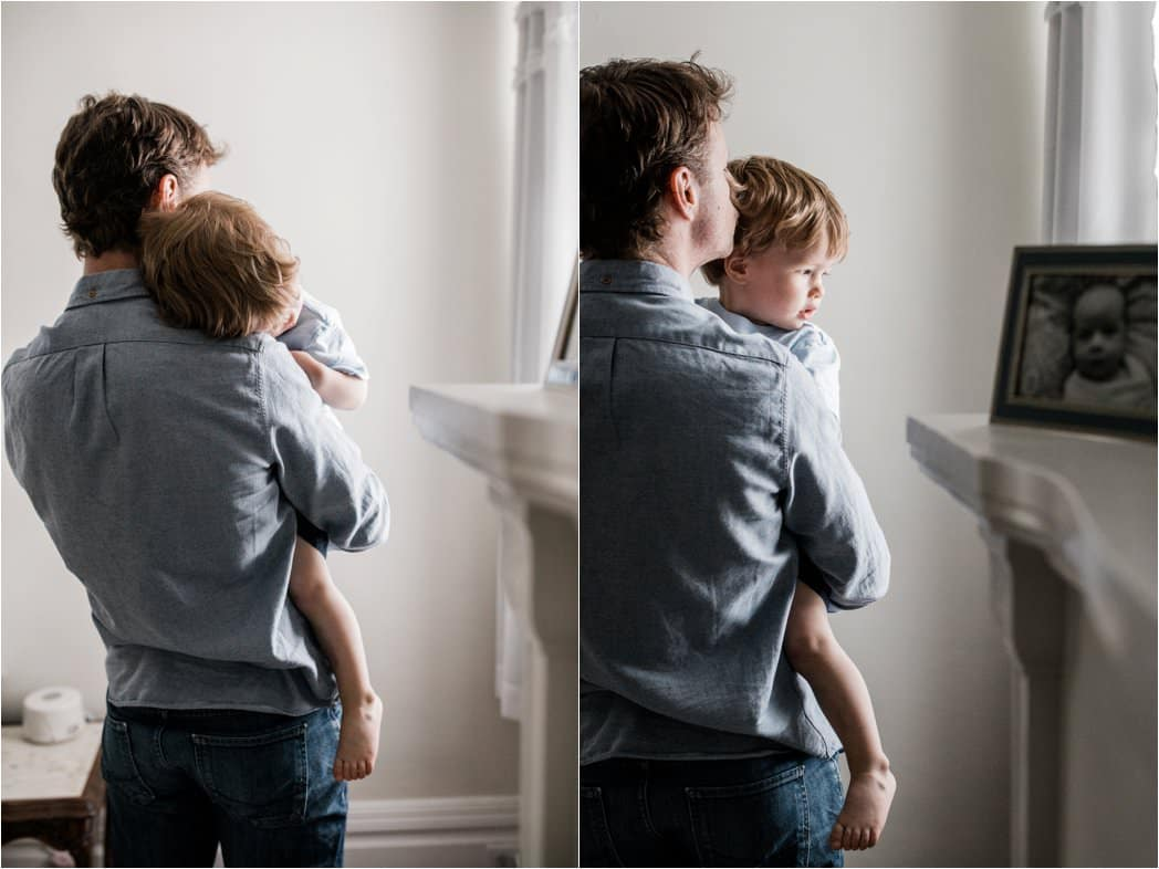 father holding toddler at family newborn session