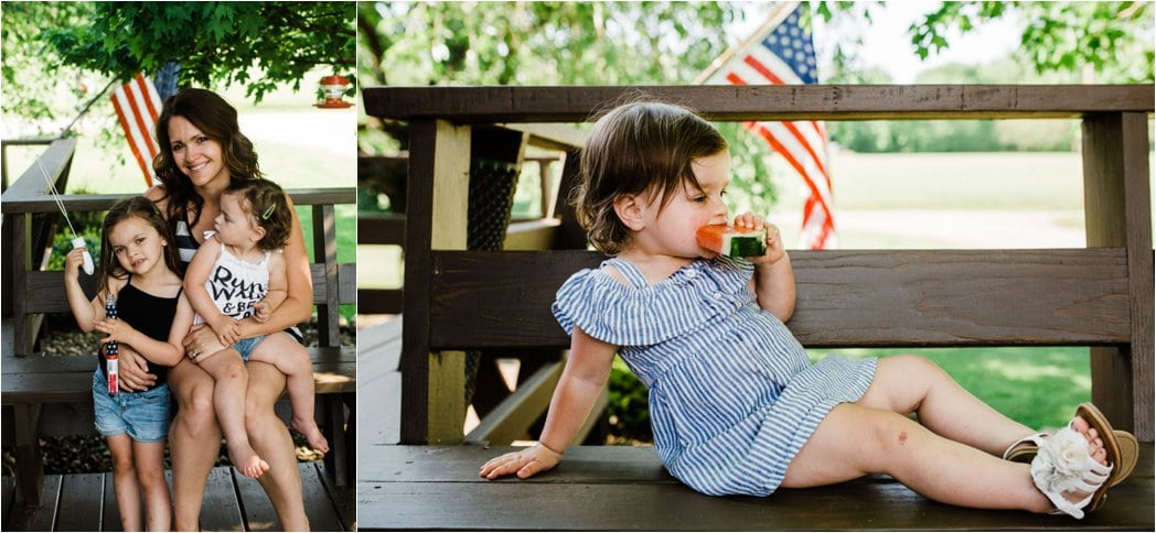 Toddler girl eating watermelon in a blue striped dress