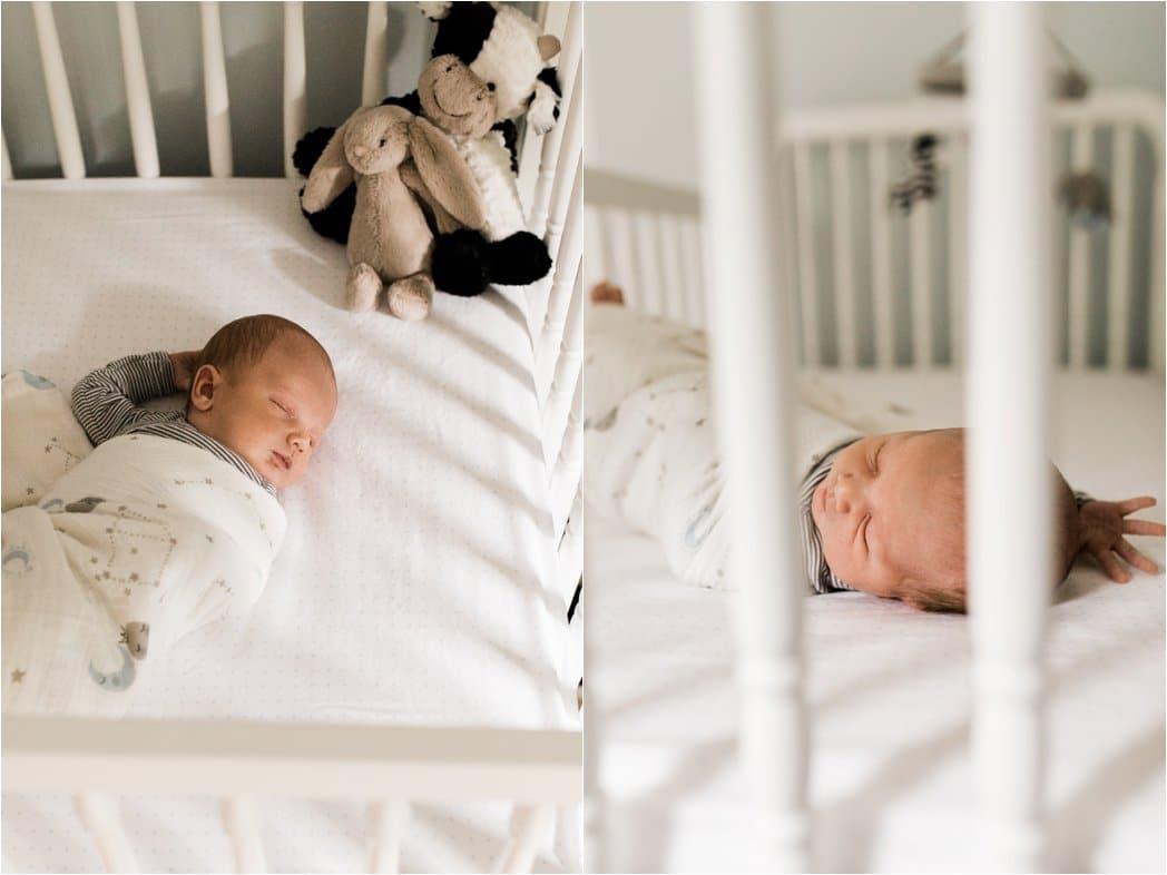 swaddled newborn baby boy in crib