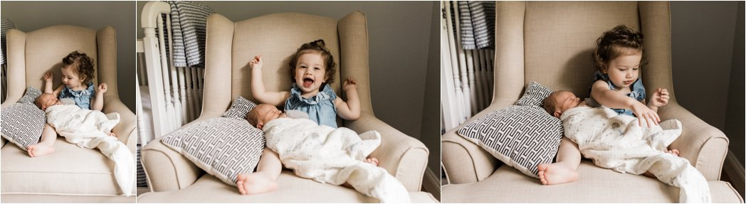 big sister warming up to newborn brother at family newborn session