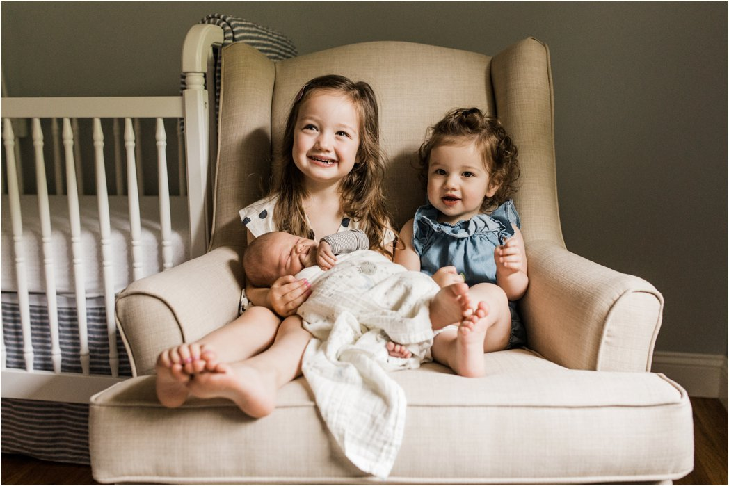 big sisters and newborn baby brother photo
