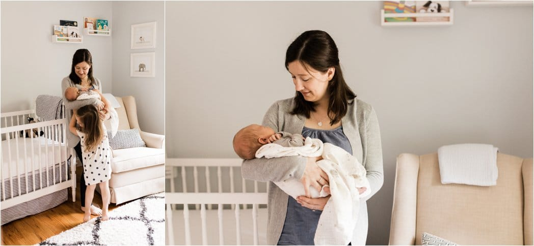 a mother hooding her newborn in the nursery