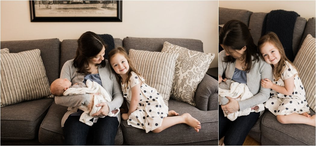 big sister snuggling mom and baby brother at home newborn session