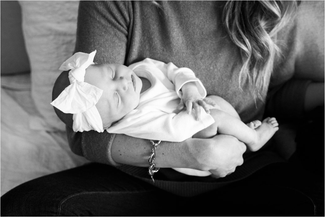 newborn baby girl in mamas arms