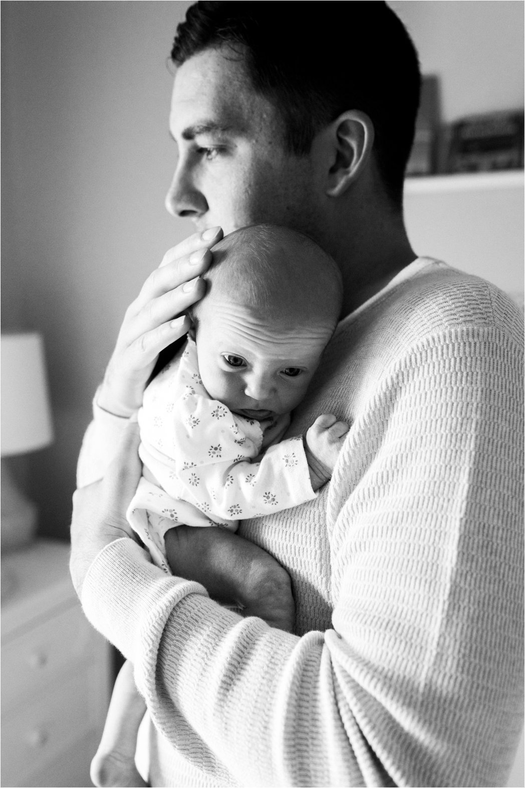 father and newborn daughter on his chest