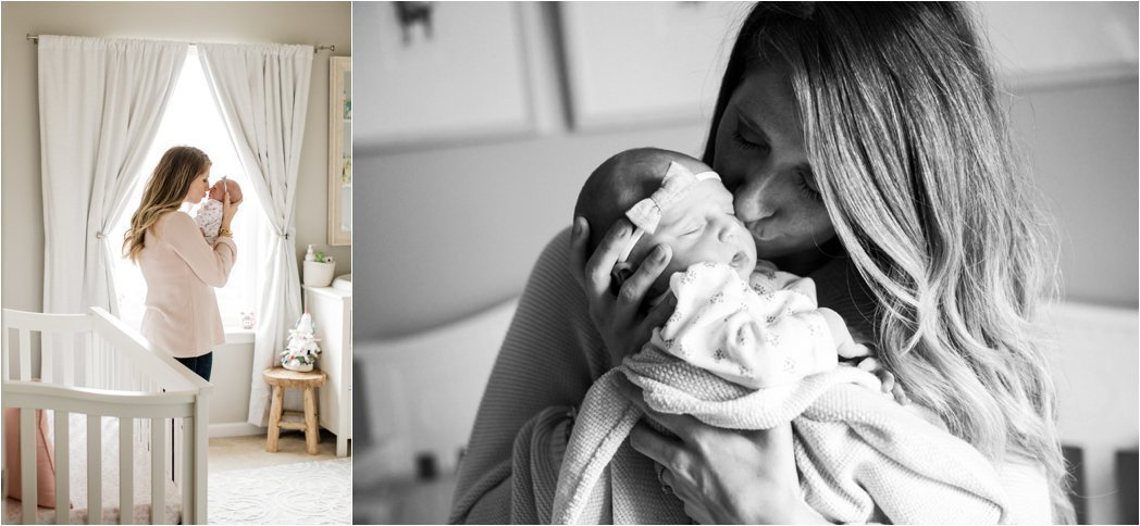 mother kissing and holding her newborn baby girl in neutral nursery