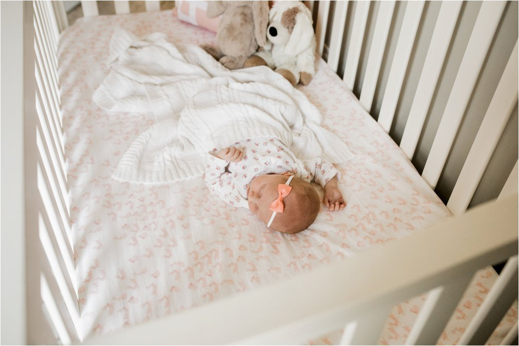 newborn baby girl sleeping in crib