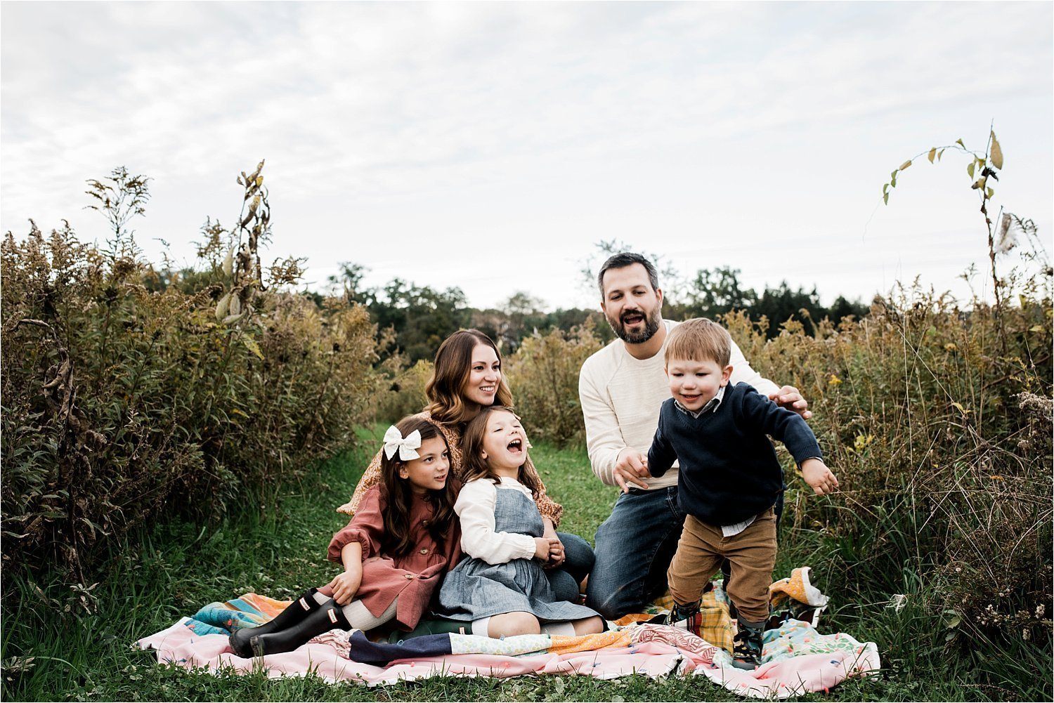 lifestyle family photo in open field