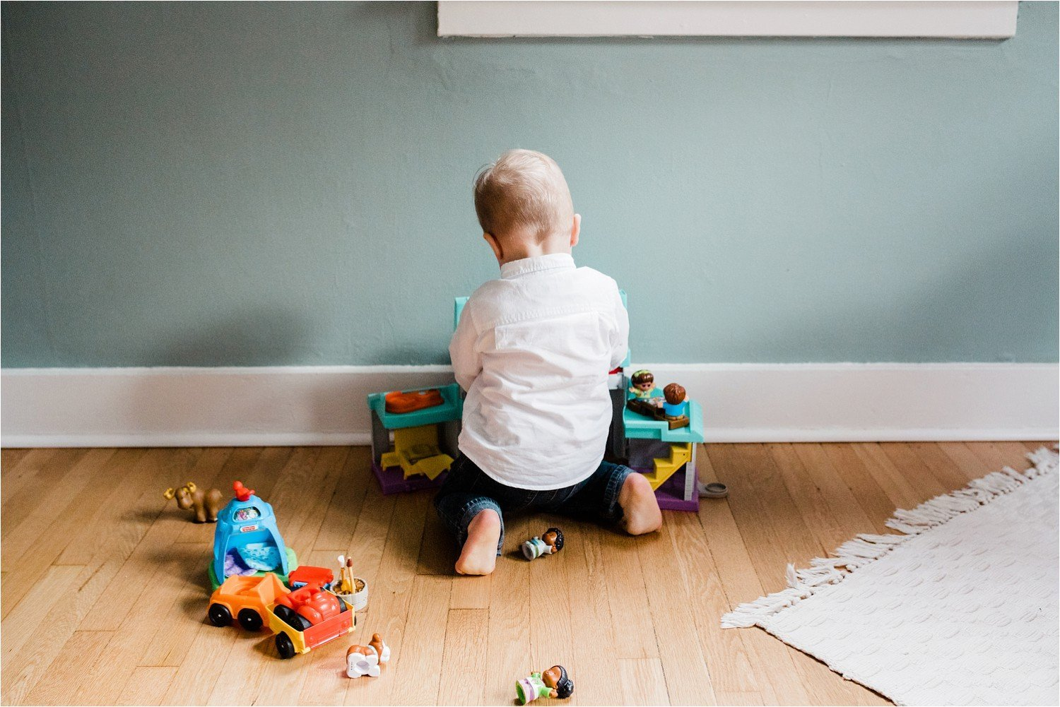 child playing in room during Family photos at home