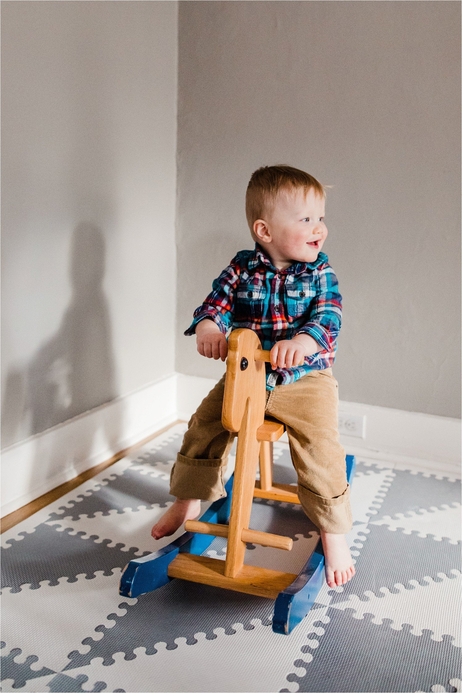 toddler boy on his rocking horse