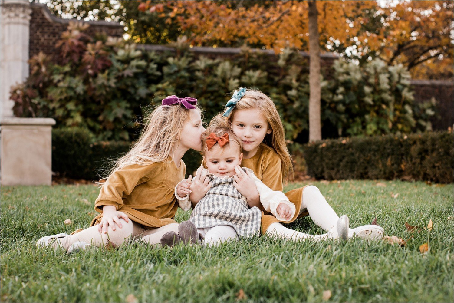 Photo of sisters in fall colored wardrobe