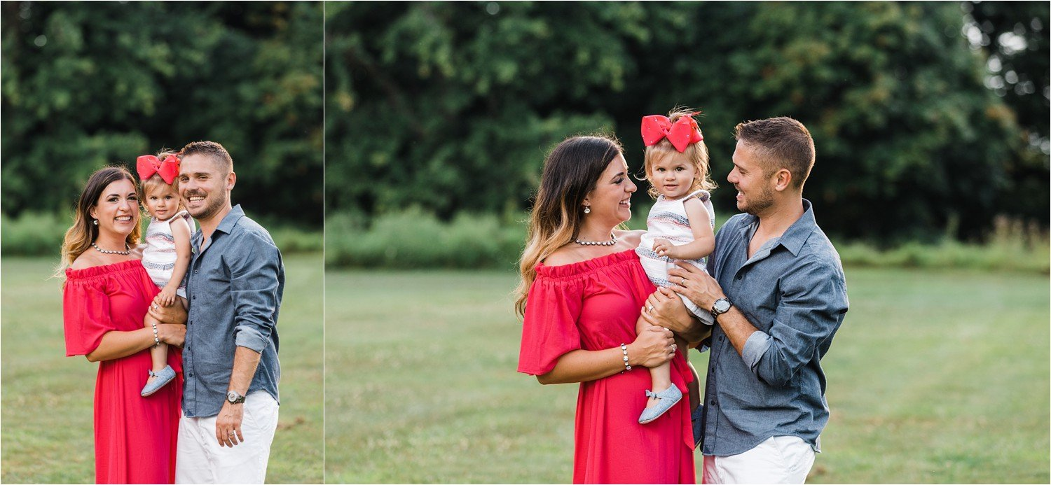 toddler girl with parents during sumer photo session