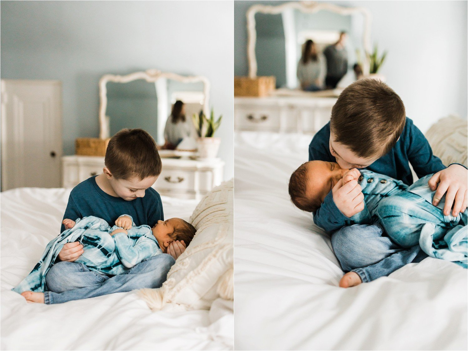 OLDEST SIBLING HOLDING NEWBORN