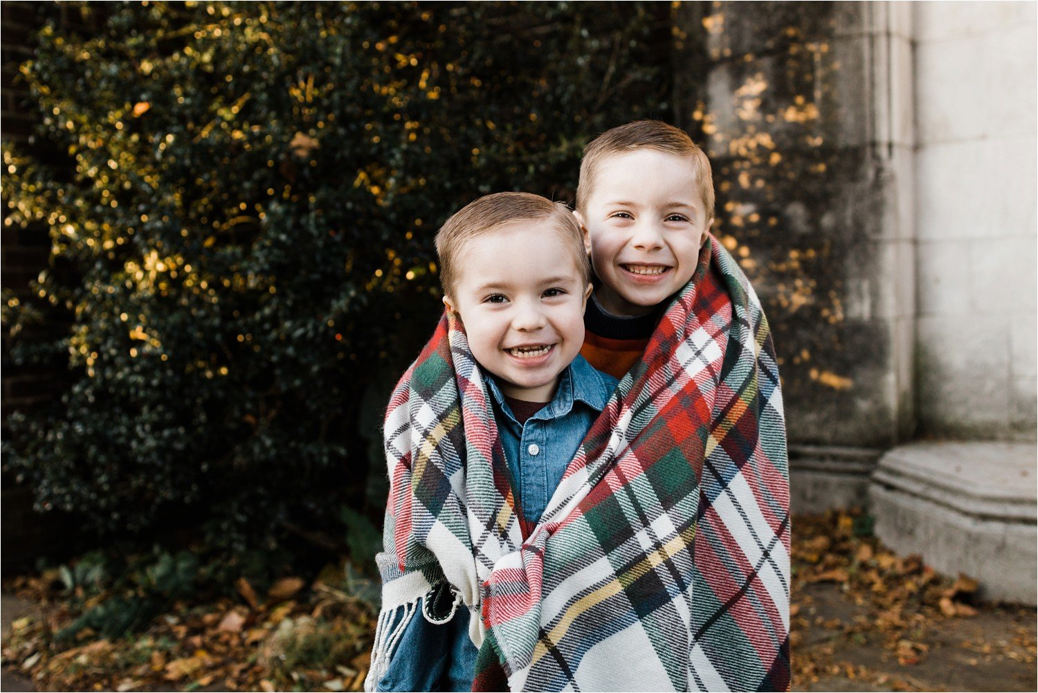 BROTHERS KEEPING WARM AT OUTDOOR FAMILY PHOTO SESSION