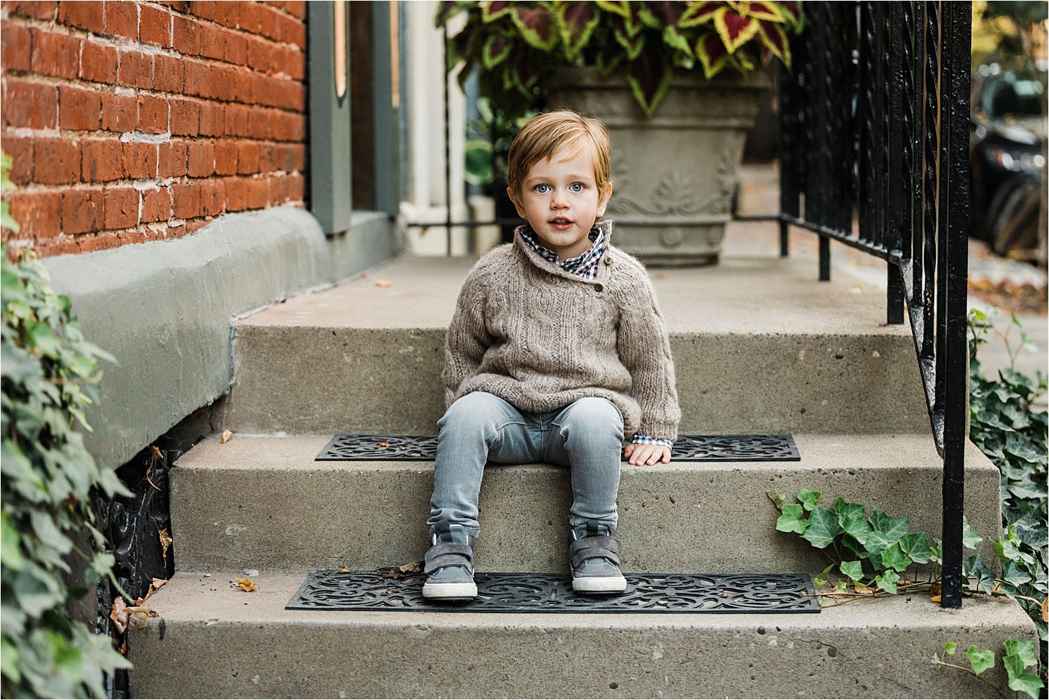 portrait of boy sitting on stoop