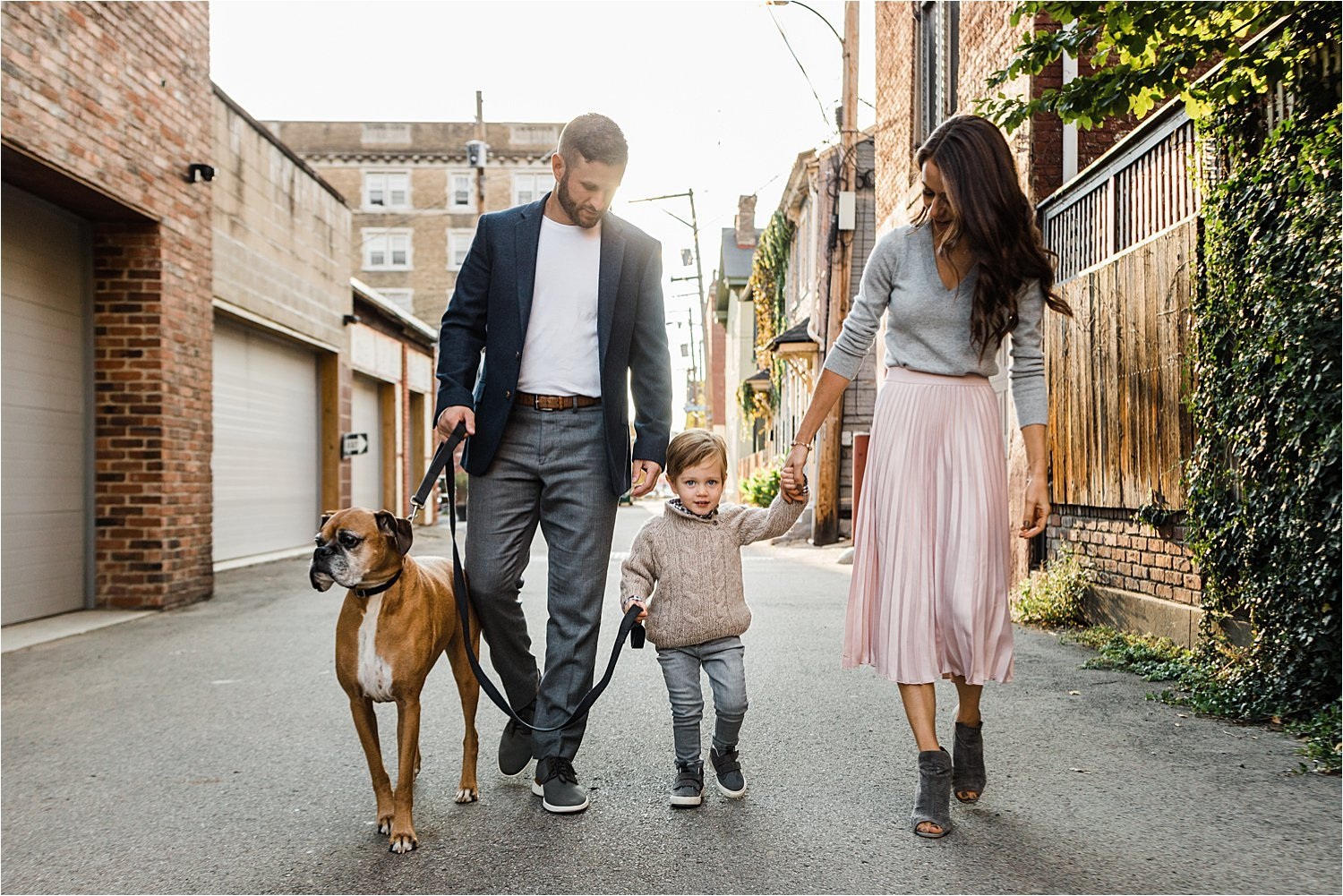 family walking dog in Pittsburgh neighborhood