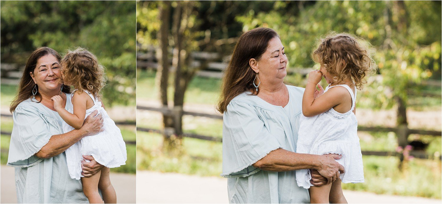 little girl held by her grandmother giving kisses