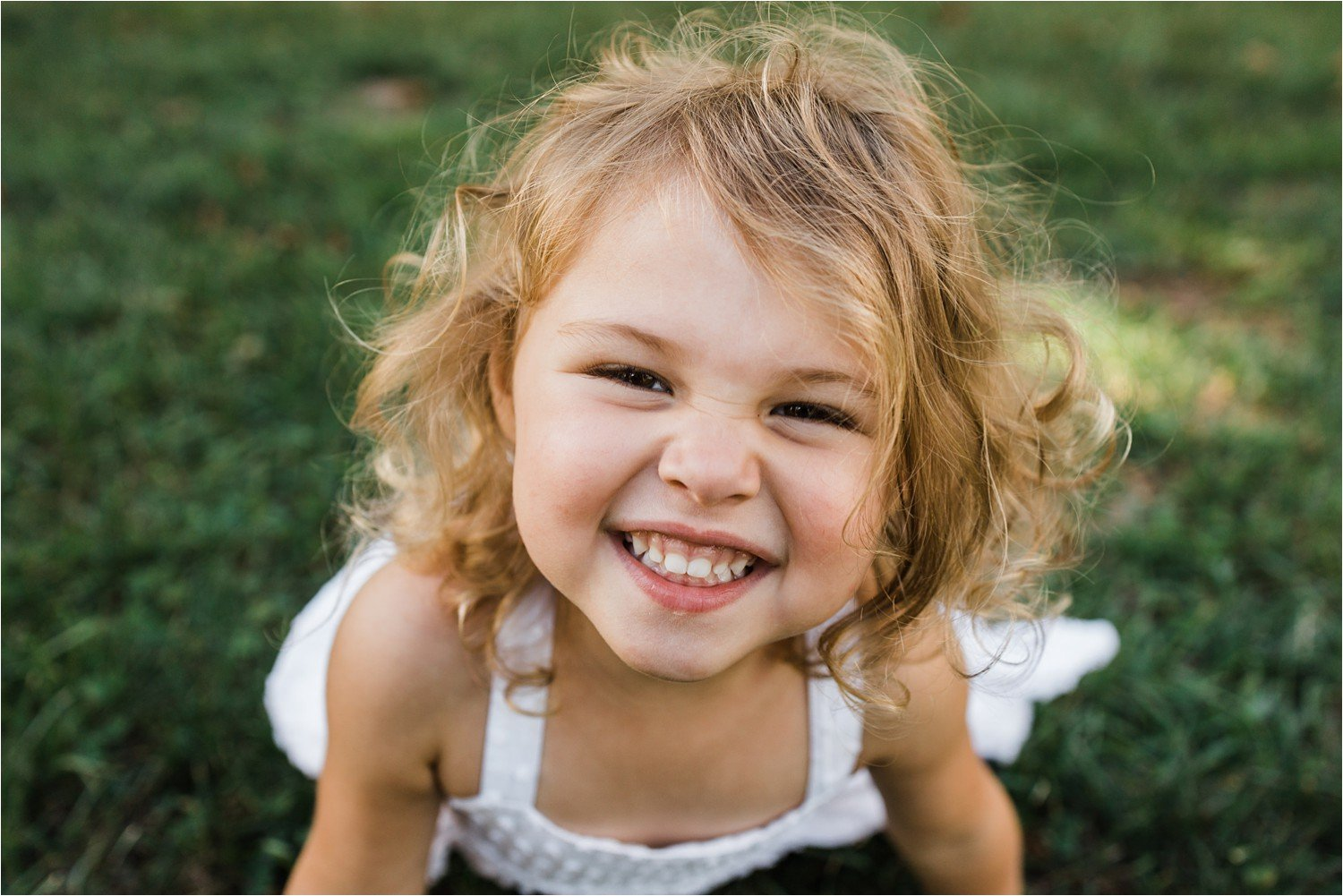 big smile on a little girl close up photo